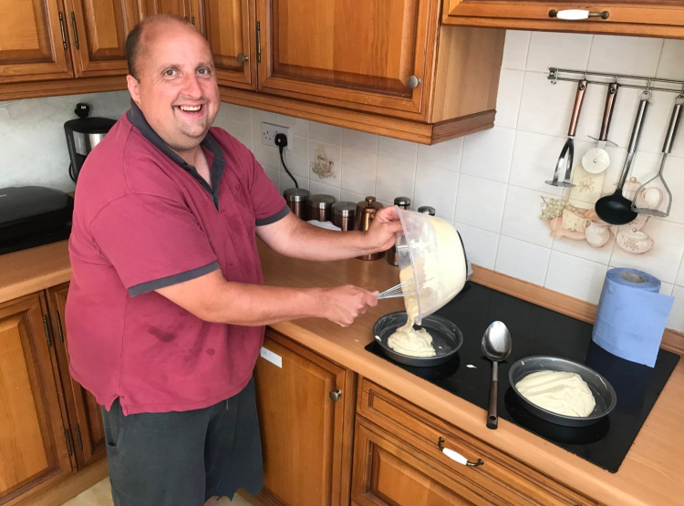 man baking cakes for bake off